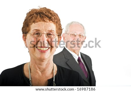 closeup  portrait off a senior businesswoman with colleague in the background isolated on white - stock photo