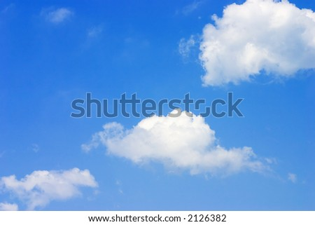 3 clouds on a bright blue sky - stock photo