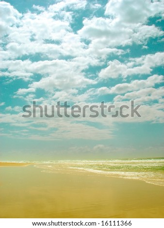 Clouds,sky and beach - stock photo