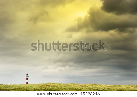 cloudscape and lighthouse at belgian coastline - stock photo