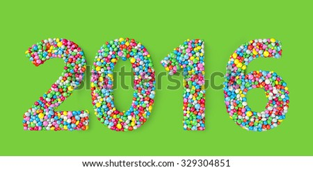 2016 coated with nonpareils of different colors isolated on green background