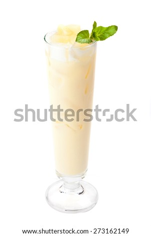 Cocktail Pina Colada  in a tall glass garnished mint leaf. Isolated on white background.