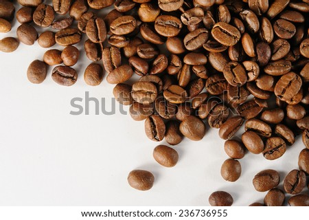 coffee beans closeup on white background - stock photo