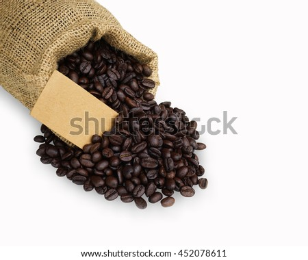 Coffee Beans in a sack bag isolated on white background. This has clipping path.                     - stock photo