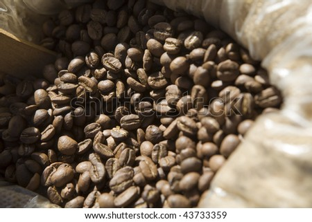 Coffee beans in sack - stock photo