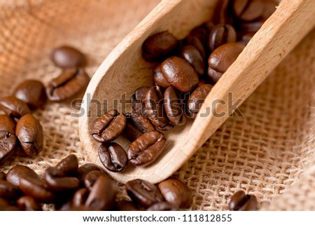 coffee beans on the cloth sack - stock photo