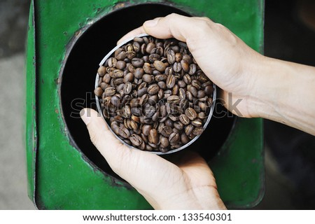 coffee - coffee beans in hand - stock photo