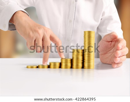 Coin to money in human hand, business ideas - stock photo