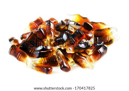 Cola flavored gummy  jellies in the shape of cola bottles,isolated over white background. - stock photo