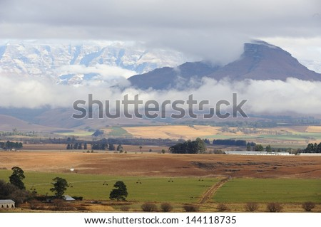 Cold air inversion. Cloud trapped in an inversion layer  hugs the ground in the the Drakensberg foothills, Underberg, kwazulu Natal, South Africa - stock photo