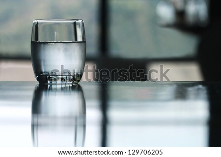 cold drinking water glass on table - stock photo