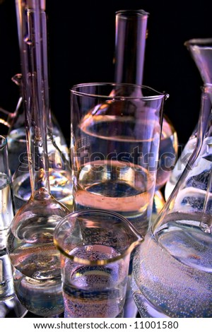 collection of the laboratory glassware on black background