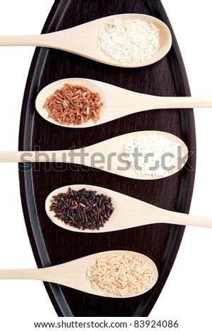 5 color brown jasmine rice on wooden tray - stock photo