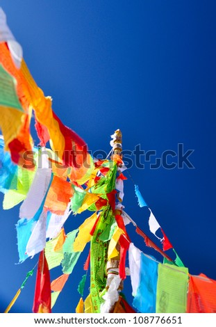 5 color flags on the top of the mountain - stock photo
