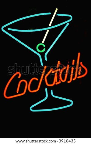 4 color neon sign in shape of cocktail glass with word cocktails in red - stock photo