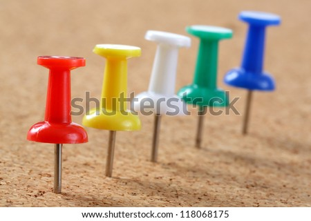 5 color pins on Cork board - stock photo