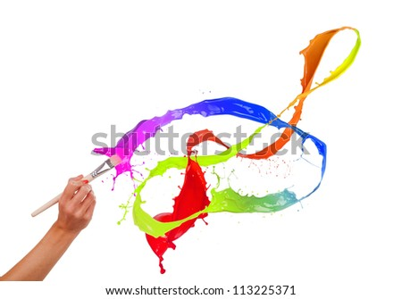 Colored paints splashing out of brush. Isolated on white background - stock photo