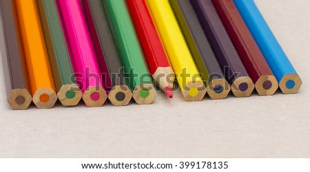 Colored pencils and a sharpened red  - stock photo