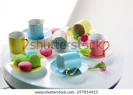colored tea cups on a white pedestal on a white background - stock photo
