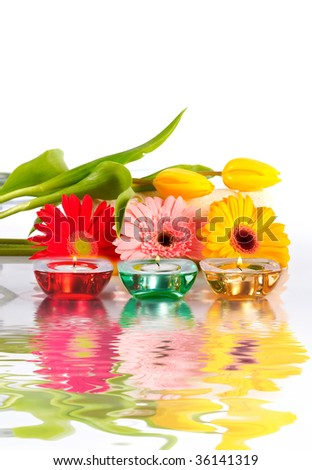 Colorful candles and flowers. Spa concept - stock photo