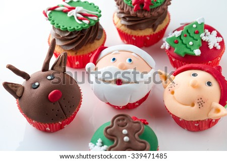 Colorful decorative Christmas cupcakes  with candy elements on top - stock photo