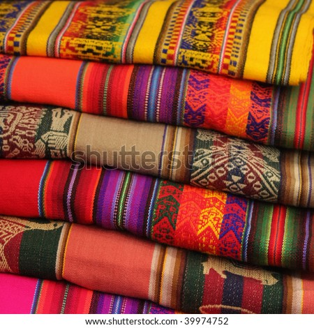 Colorful Fabric at Pisac market in Peru - stock photo