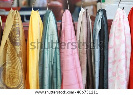 colorful fabric hang background, pink gold and blue color silk fabric hang on wall  - stock photo
