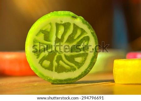 Colorful mugs fruit caramel on a wooden table. - stock photo