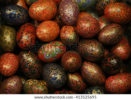 colorful paint egg, dark tone, egg craft made from wood and paint color with Arab art style. - stock photo