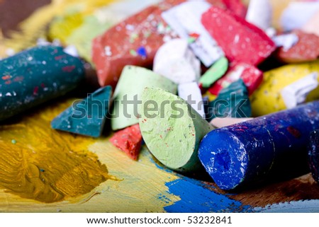 Colorful pastel sticks on painting background