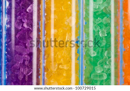 colorful salt crystals in lab test tubes - stock photo
