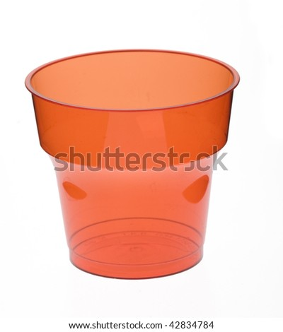 Colourful plastic glass isolated over white background