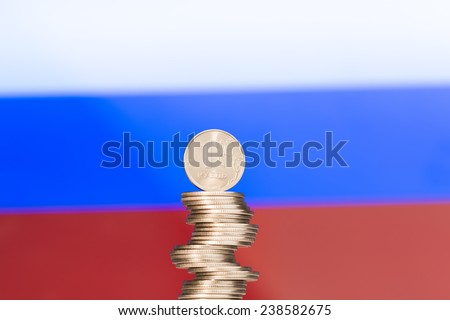 Column of rubles  over the Russian flag - stock photo