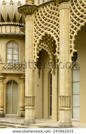 columns at Royal Pavillon, view of columns of highly decorated building in center of touristic sea town, shot from the public street,  Brighton, East Sussex  - stock photo