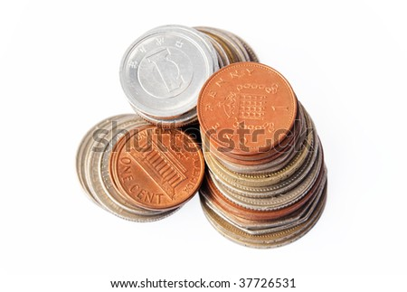 3 columns of coins - Pound Sterling, US dollars and Japanese Yen. Focus on the top of the Pound Sterling column. - stock photo