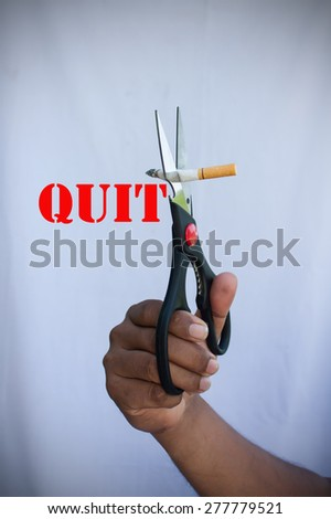 concept no smoking,man use scissor cutting cigarette quit smoking - stock photo