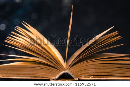 concept of an open book with bokeh effect