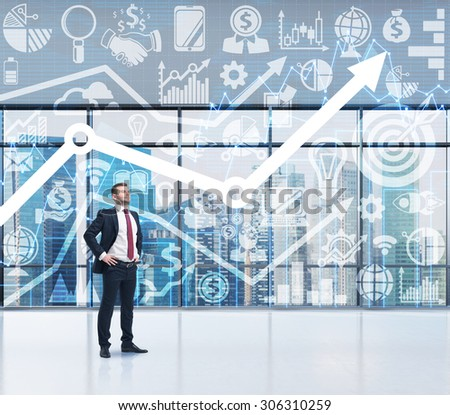 confident businessman who is thinking about the concept of the business development. Growing arrow and business icons on the background as a symbol of the success. Singapore view in blur. - stock photo