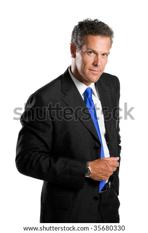 Confident mature businessman standing isolated on white background and looking at camera - stock photo