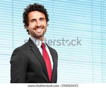 Confident young businessman in his office  - stock photo