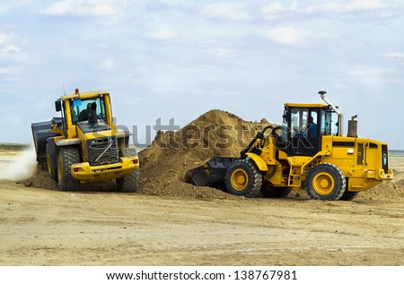 construction of the road, digging works by means of special equipment - stock photo