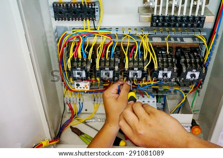 contactor wiring work in motor control panel                               - stock photo