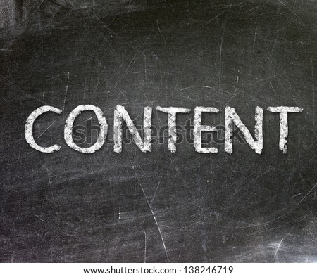 """""""Content"""" handwritten with white chalk on a blackboard - stock photo"""