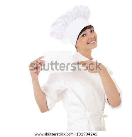 cook woman pointing on empty card, white background - stock photo