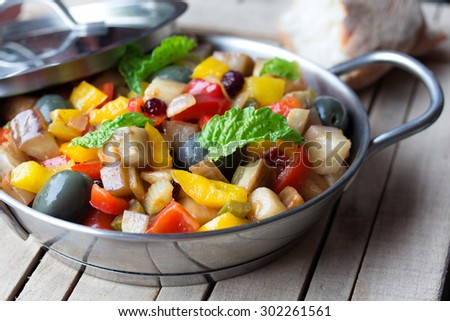 vegetable salad made from chopped fried eggplant. Traditional sicilian ...