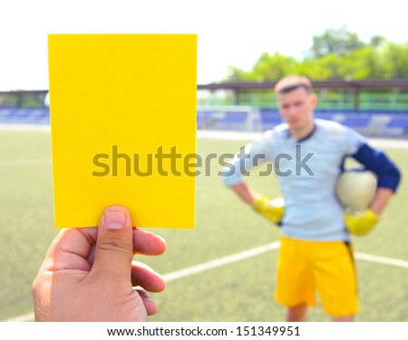 Copy space for inscription Football referee Hand holding and showing yellow card   - stock photo