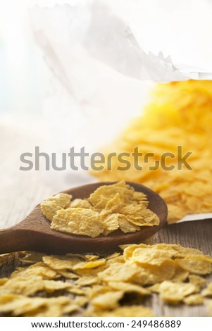 Cornflakes in wooden spoo - stock photo