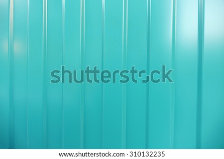 Corrugated iron is new. Texture color. Background  cyan, aquamarine.                               - stock photo
