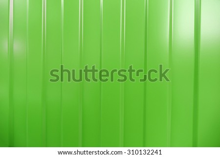 Corrugated iron is new. Texture color. Background green.