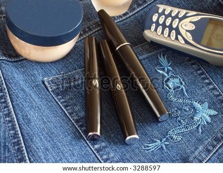 cosmetic  and telephone in jeans - stock photo